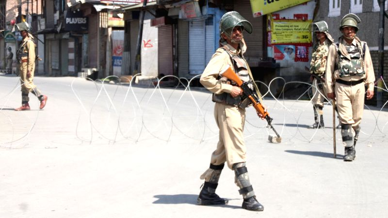 Barbed wires laid on a streets of Srinagar as authorities impose curfew in Kashmir valley on July 29, 2016.