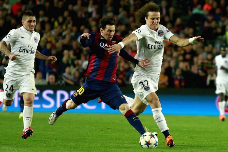 Barcelona's Lionel Messi (C) vies for a ball with Paris Saint-Germain's David Luiz (R) during their UEFA Champions League quarter-finals second leg match in ...