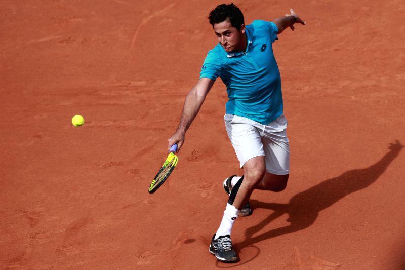 "Spanish player Nicolas Almagro returns the ball to his compatriot Rafael Nadal during the ATP Barcelona Open ""Conde de Godo"" tennis tournament in ..."