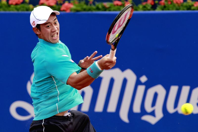"Japan's Kei Nishikori returns a shot during the final against Spain's Pablo Andujar at the ATP Barcelona Open ""Conde de Godo"" tennis tournament in ..."