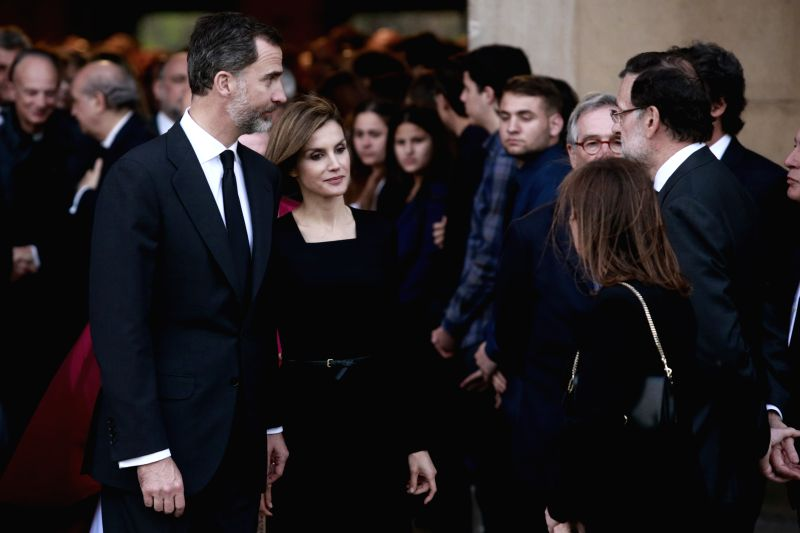 King Felipe VI and Queen of Spain talk to families of victims during the funeral mass held at the Sagrada Familia in Barcelona, Spain, April 27, 2015. Spain on ...