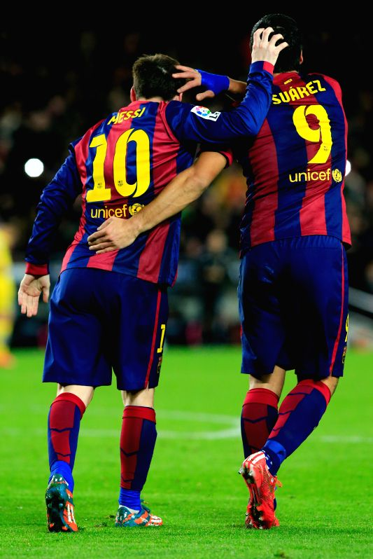 Barcelona's Lionel Messi (L) celebrates his goal with teammate Luis Suarez during the King's Cup semifinal first leg soccer match against Villareal at the Nou ...