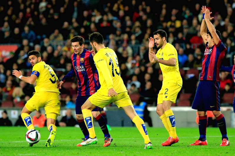 Barcelona's Lionel Messi (2nd L) and Luis Suarez (1st R) vie with Villareal's Dos Santos (1st L), Ruiz (C) and Mario during the King's Cup semifinal first leg ...