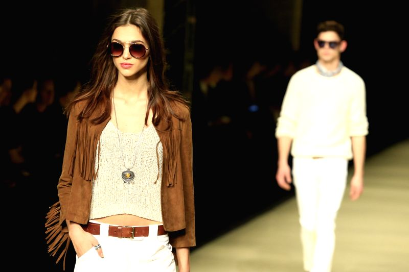 Models present creations by Mango during the 15th Barcelona Fashion Week in Barcelona, Spain, Feb. 2, 2015.