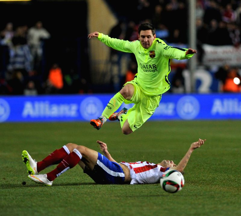 Barcelona's Messi competes during the King's Cup quarter-final second leg match against Atletico Madrid at the Vicente Calderon Stadium in Madrid, Spain, Jan. ...