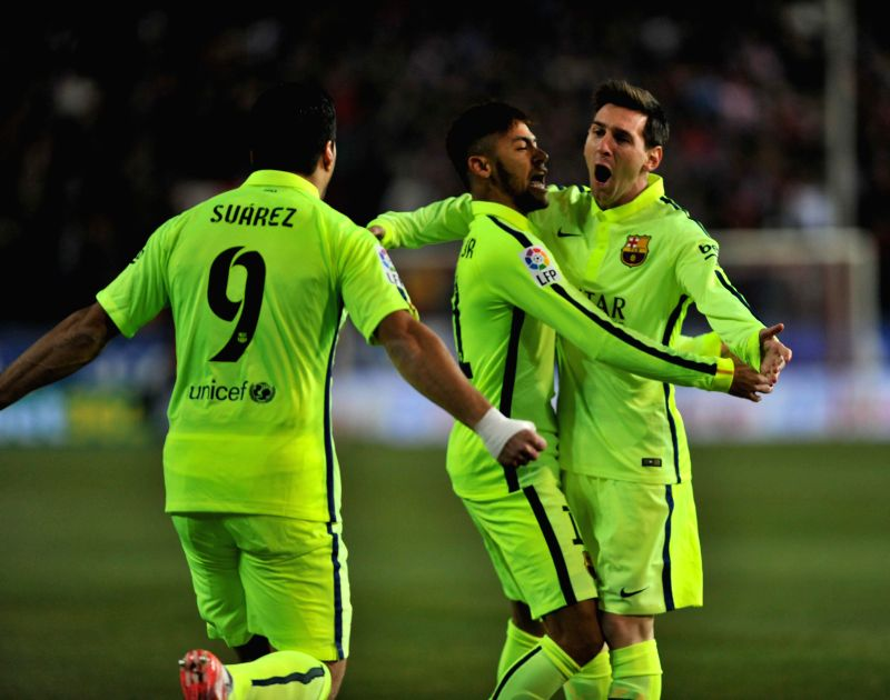 Barcelona's players Lionel Messi, Luis Su?rez and Neymar Jr. celebrate their goal during the King's Cup quarter-final second leg match against Atletico Madrid at