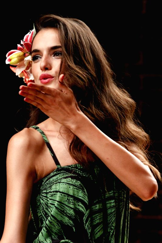 A model presents a creation by Desigual for Spring Summer 2015 during the 14th Barcelona Fashion Week in Barcelona, Spain, July, 1, 2014.