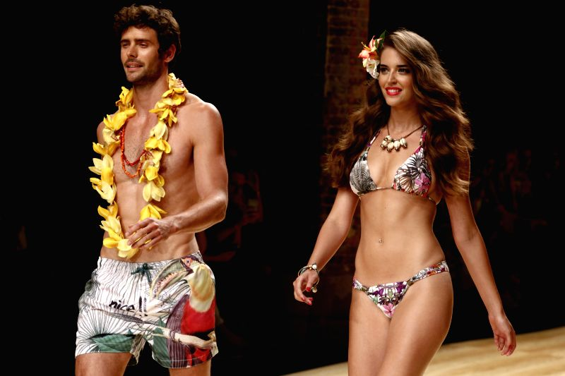 Models present creations by Desigual for Spring Summer 2015 during the 14th Barcelona Fashion Week in Barcelona, Spain, July, 1, 2014.