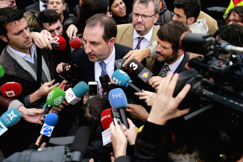The Catalan Minister of Interior Ramon Espadaler(C) speaks to media at Barcelona's El Prat airport in Barcelona, Spain, on March 24, 2015. An Airbus A320 of the ...