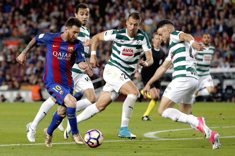 BARCELONA, May 22, 2017 - Barcelona's Lionel Messi (L) runs with the ball during the Spanish first division soccer match between FC Barcelona and SD Eibar at the Camp Nou Stadium in Barcelona, Spain, ...