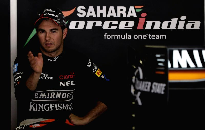 Mexican F-1 driver Sergio Perez, of Force India team, rests in his garage during the first free training session at Circuit de Barcelona-Catalunya track, in Montmelo, outside Barcelona, ...