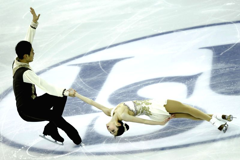 Barcelona (Spain): China's Yu Xiaoyu (R)and Jin Yang perform during Pairs Short Program of the ISU Grand Prix of Figure Skating Final & Junior Grand Prix Final in Barcelona, Spain, on Dec. 11, ...