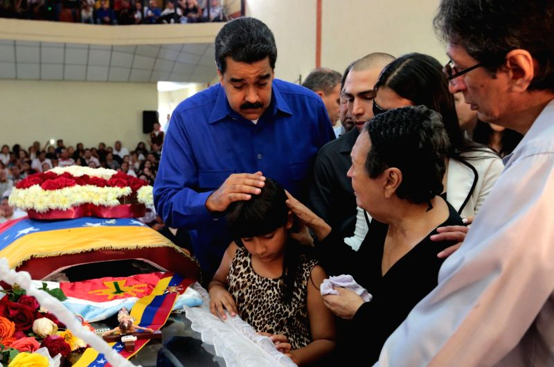 BARINAS, July 20, 2016 - Image provided by the Venezuelan Presidency shows President Nicolas Maduro (R) interacting with a girl during the funeral of Anibal Chavez, brother of late Venezuelan ...