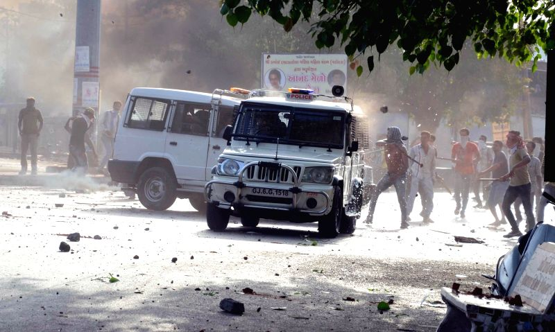 Baroda : A mob attacks police vehicles after violence breaks out during a Baroda Municipal Corporation demolition drive  on May 31, 2016.