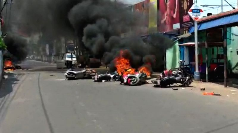 Barrackpore: A view of vehicles set on fire by an irate mob after violence broke out between TMC and BJP workers, after counting for the votes cast in the 2019 Lok Sabha polls concluded, in West Bengal's Barrackpore, on May 24, 2019. (Photo: Indrajit