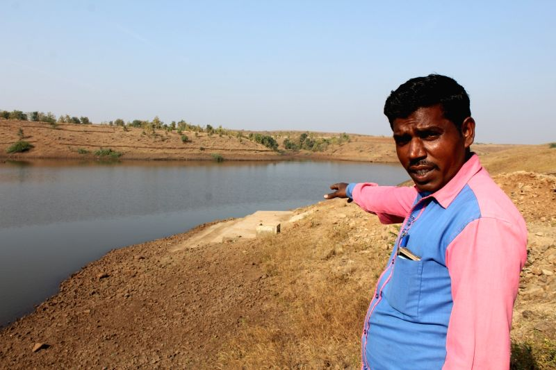 :Basanta Vasunya shows the pond, ghat and a small tank especially to store live fishes for Bohra Muslim community which abstain from buying dead fishes..(Image Source: IANS)