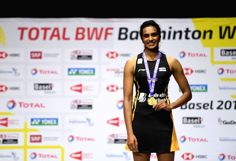 BASEL, Aug. 25, 2019 (Xinhua) -- India's Sindhu Pusarla V. poses on the podium during the awarding ceremnoy after the women's singles final match against Japan's Okuhara Nozomi at the BWF Badminton World Championships 2019 in Basel, Switzerland, Aug.