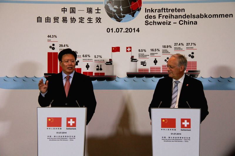 China's ambassador to the World Trade Organization Yu Jianhua (L) and Swiss Federal Councilor Johann Schneider-Ammann attend a press conference held in the Rhine port
