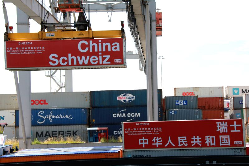 The first tariff-free goods are seen after being landed in the Rhine port in Basel, Switzerland, July 1, 2014. With the witness of first tariff-free goods landed and ..
