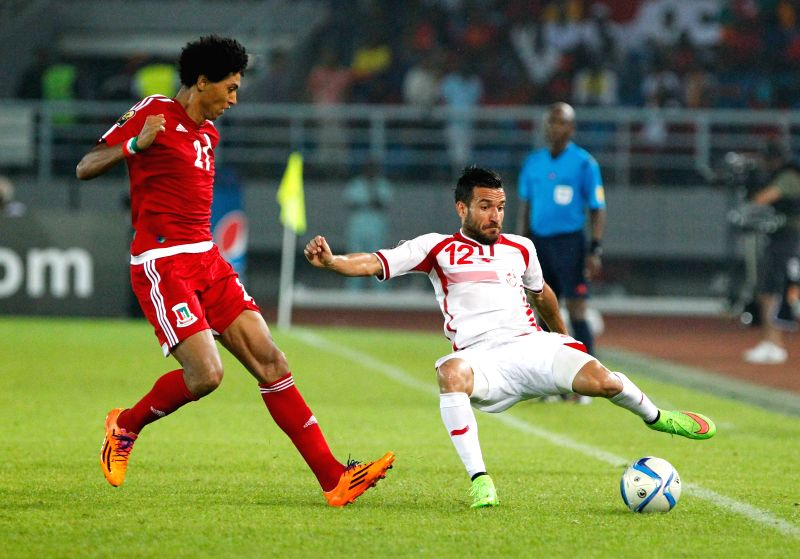 Ali Maaloul (R) of Tunisia vies for the ball during a quarterfinal match of Africa Cup of Nations between Equatorial Guinea and Tunisia at the Stadium of Bata, ...