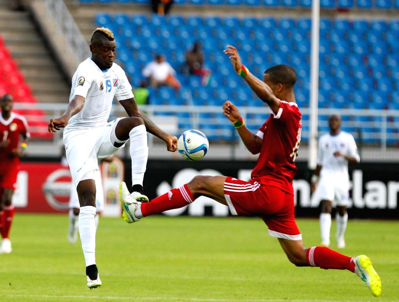 Loteteka Bokila (L) of the Democratic Republic of Congo vies for the ball during a quarterfinal match of Africa Cup of Nations between Congo and the Democratic Republic