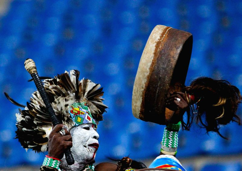 A fan of the Democratic Republic of Congo (DR Congo) beats the drum before a semi-final match of Africa Cup of Nations between Cote d'Ivoire and DR Congo in Bata, ...