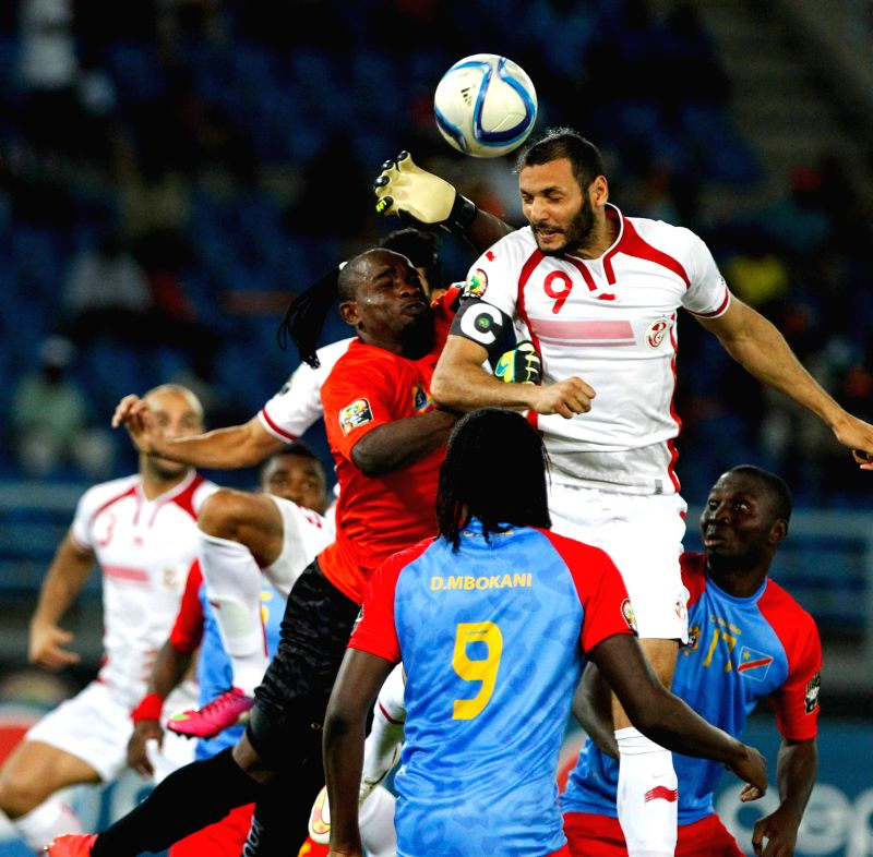 Yasine Chikhaoui (2nd R) of Tunisia competes during a group match of Africa Cup of Nations against the Democratic Republic of Congo (DR Congo) in Bata, Equatorial ...