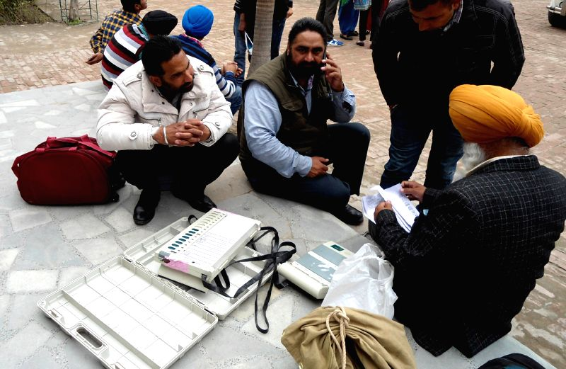 Polling personnel inspect EVMs ahead of the Punjab civic body polls on 25th Feb 2015, in Batala on Feb 24, 2015.