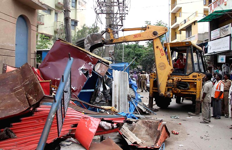 BBMP official demolished illegal shops at Bazar Street, Neelasandra, in Bangalore on June 21, 2014.