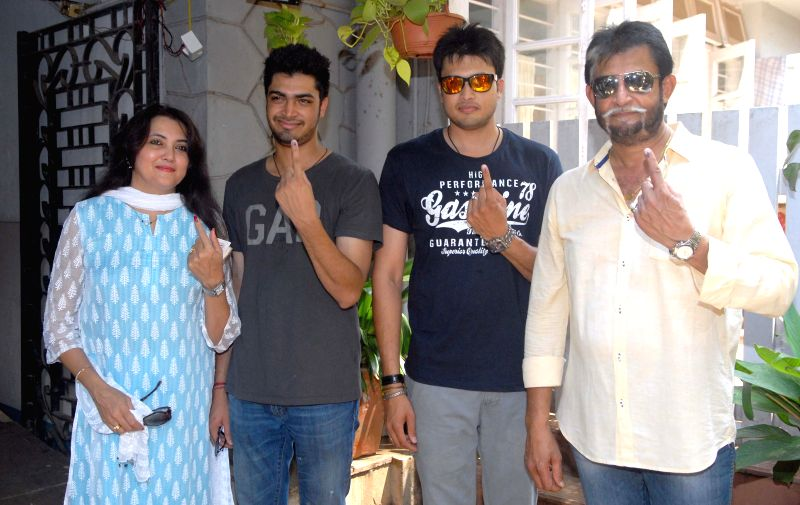 BCCI chief selector Sandeep Patil shows his fore finger marked with phosphorous ink after casting his vote during the sixth phase of 2014 Lok Sabha Polls in Mumbai on April 24, 2014.