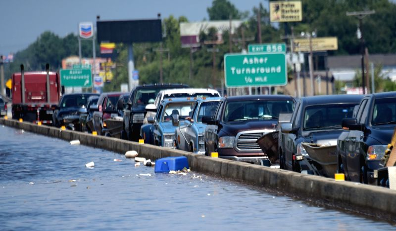 BEAUMONT (U.S.), Aug. 31, 2017 Vehicles are seen on a flooded highway in Beaumont, Texas, the United States, Aug. 31, 2017. Nearly 40 people died or are feared dead in flooding or ...