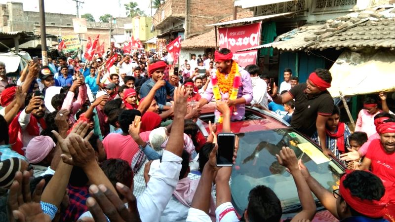 Begusarai: CPI's Lok Sabha candidate from Begusarai, Kanhaiya Kumar greets supporter during a roadshow, in Bihar's Begusarai on April 23, 2019.