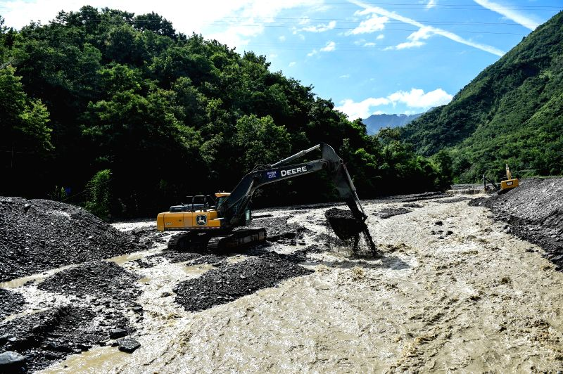 BEICHUAN, July 12, 2018 - A river is cleaned up in Chenjiaba Town of Beichuan County, southwest China's Sichuan Province, July 12, 2018. Lasting torrentials in the past days have caused severe flood ...