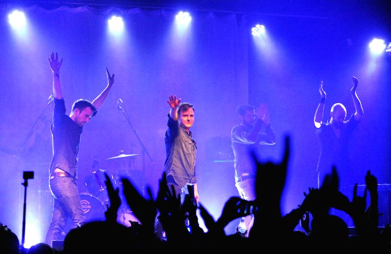 """Danish post-rock band """"The Seven Mile Journey"""" greet audience after their performance at a solo concert in Beijing, capital of China, April 11, 2015. ..."""