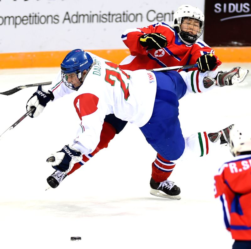 Eleonora Dalpra (L) of Italy falls down during the match between Italy and the Democratic People's Republic of Korea at the 2015 IIHF Women's World Championship ...