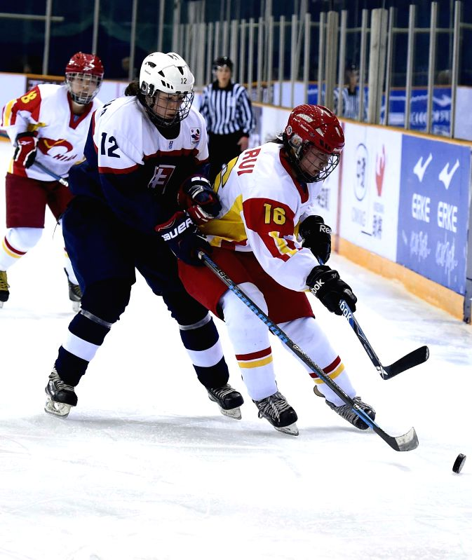 Ma Rui (R) of China vies the puck with Maria Herichova of Slovakia during the match between China and Slovakia at the 2015 IIHF Ice Hockey Women's World ...