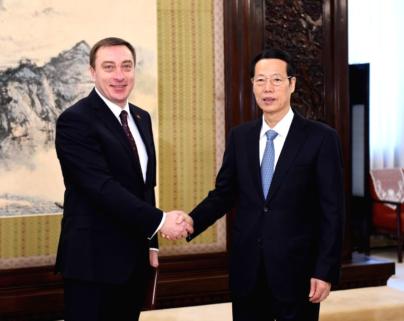 Chinese Vice Premier Zhang Gaoli (R) meets with Belarusian deputy director of the Presidential Office Nikolay Snopkov in Beijing, capital of China, April 13, 2015. ...