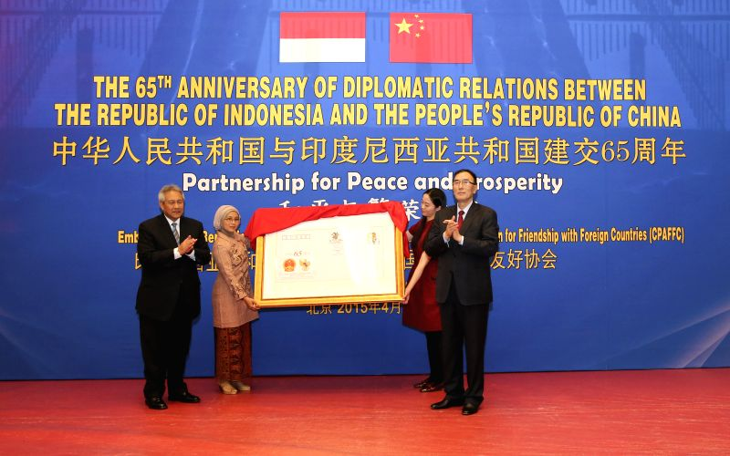 Qiangba Puncog (R), vice-chairman of the Standing Committee of China's National People's Congress (NPC), attends a reception commemorating diplomatic ties between ...