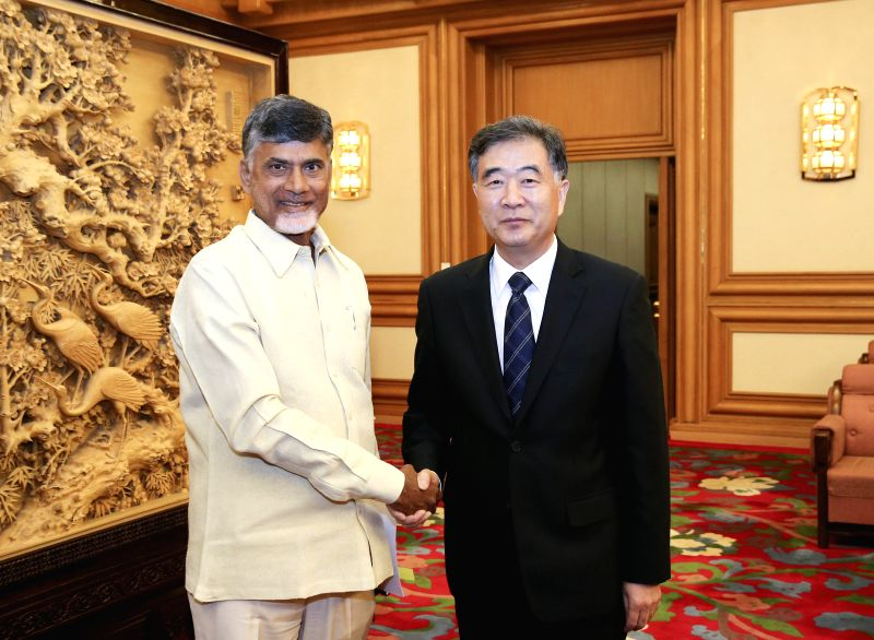 Chinese Vice Premier Wang Yang  (R) meets with Nara Chandrababu Naidu, chief minister of Andhra Pradesh and President of Telugu Desam Party (TDP), in Beijing, ... - Chandrababu Naidu