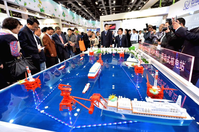 """Visitors view a model of a floating nuclear power station  at the exhibition """"Nuclear Industry China 2014"""" in Beijing, China, April 15, 2014. The ..."""
