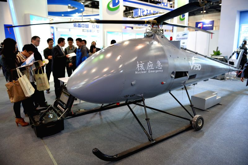 """Visitors view an unmanned nuclear emergency helicopter at the exhibition """"Nuclear Industry China 2014"""" in Beijing, China, April 15, 2014. The four-day ..."""