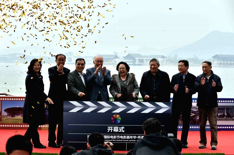 Guests attend the opening ceremony of the film carnival of Beijing International Film Festival at the Yanqi Lake scenic area in Beijing, capital of China, April ...