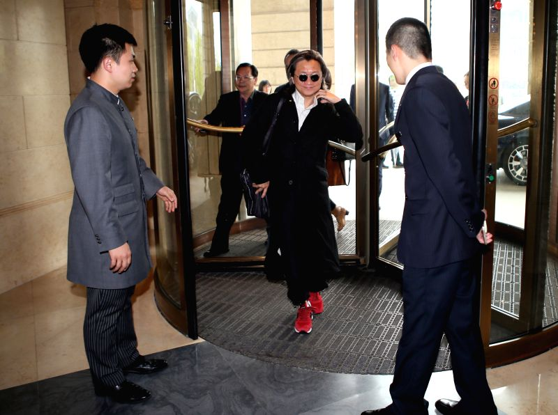 Jury of the 5th Beijing International Film Festival Peter Chan (C) arrives in Beijing, capital of China, April 15, 2015. The festival will kick off on April 16. ...