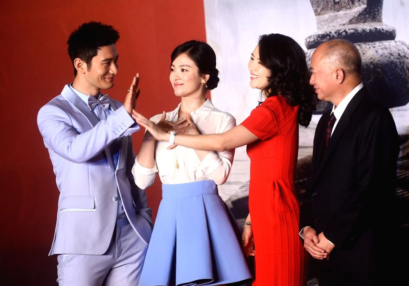 Actor Huang Xiaoming, actress Song Hye-kyo, actress Zhang Ziyi and director John Woo (from L to R) attend a press conference for the wrapping of their new movie ... - Huang Xiaoming