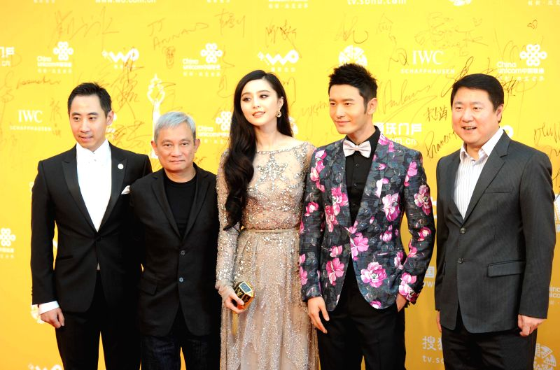 Chinese actor Huang Xiaoming (2nd R) and actress Fan Bingbing (C)pose for photos on the red carpet at the opening ceremony of the 4th Beijing International Film ... - Huang Xiaoming