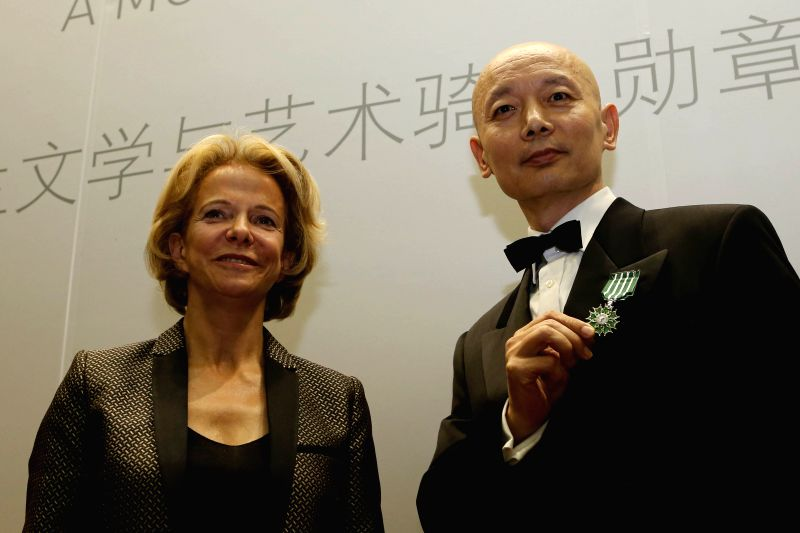 Chinese actor Ge You (R) receives the Chevalier medal in the Order of Arts and Letters from Frederique Bredin, President of French National Center of ...