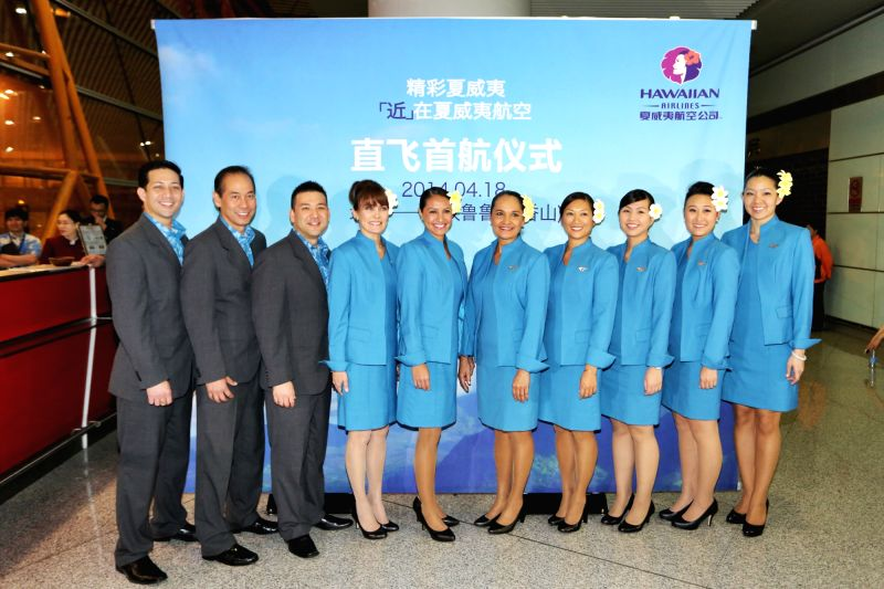 Working staff of Hawaiian Airlines pose for photos at a ceremony celebrating the opening of Honolulu-Beijing direct flights by Hawaiian Airlines at the Beijing ...