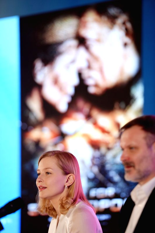 "Leading actress Yulia Peresild (L) of ""Battle of Sevastopol"" answers questions at a press conference of the movie as part of the 5th Beijing ... - Yulia Peresild"