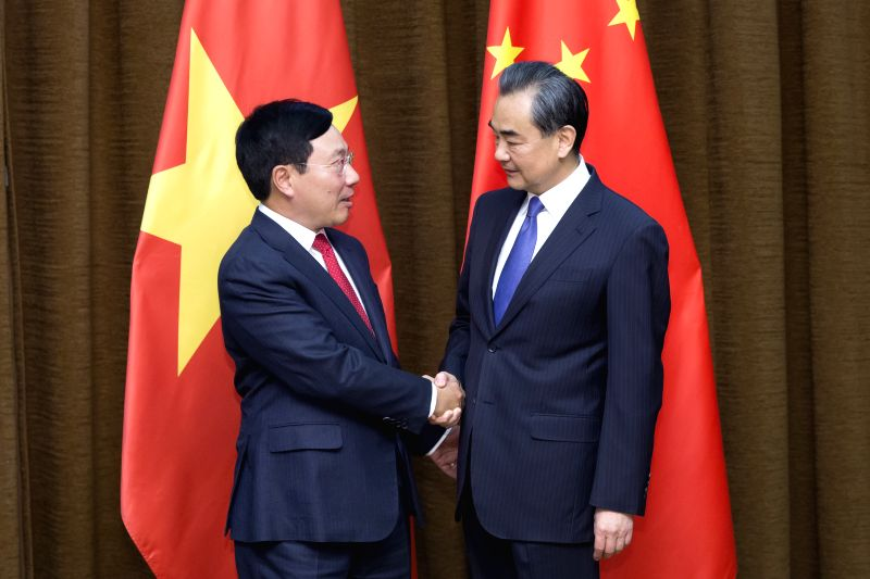BEIJING, April 18, 2017 - Chinese Foreign Minister Wang Yi (R) meets with Vietnamese Deputy Prime Minister and Foreign Minister Pham Binh Minh in Beijing, capital of China, April 18, 2017. - Wang Y