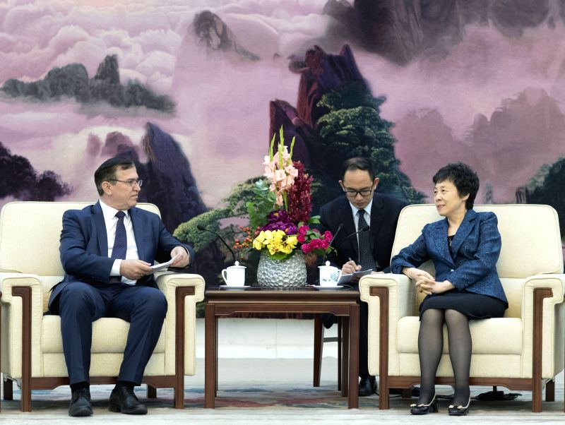 BEIJING, April 18, 2017 - Yan Junqi (R), vice chairwoman of the Standing Committee of China's National People's Congress, meets with a delegation of the People's Democratic Party of Tajikistan (PDPT) ...